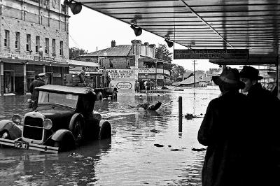 Flood damage in High Street, Maitland's main  street 1955