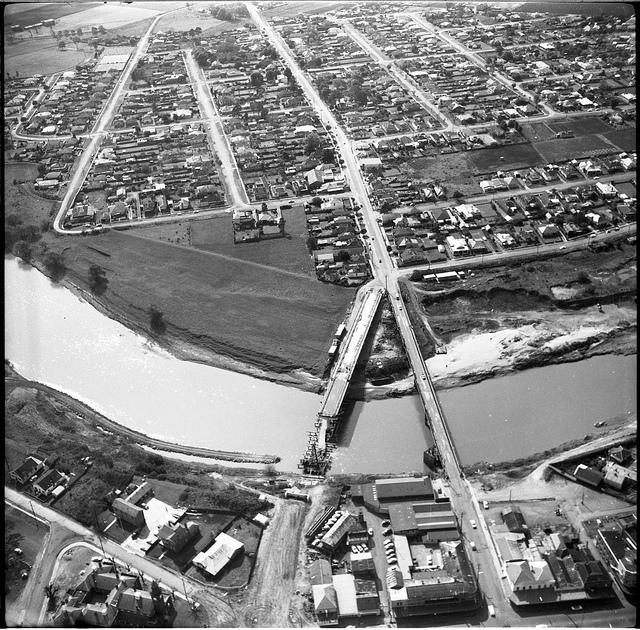 New and Old Belmore Bridge from the air, Maitland, 1963